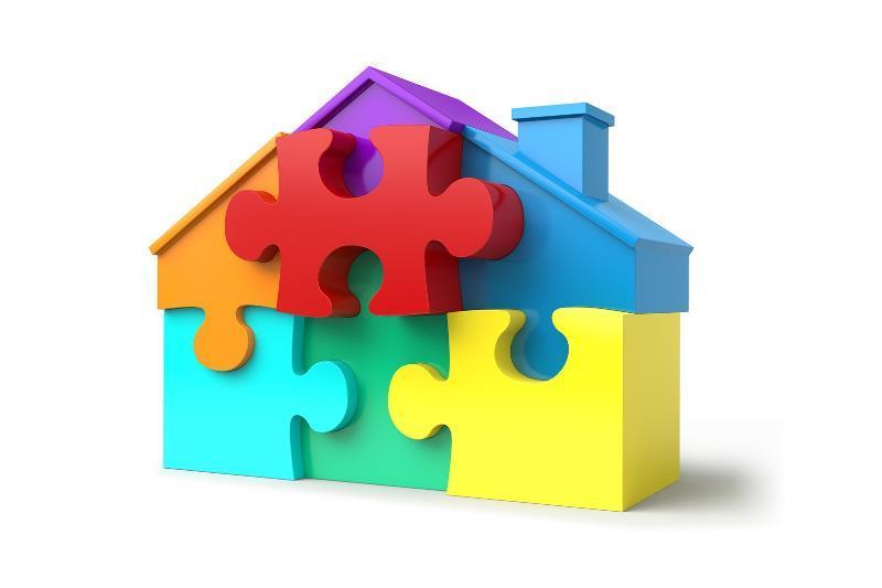 Blocchetti di un puzzle che formano una casa