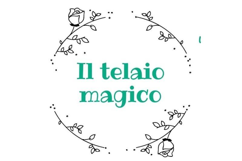 """Scritta: """"Il telaio magico"""""""